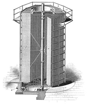 "Cooling tower - A 1902 engraving of ""Barnard's fanless self-cooling tower"", an early large evaporative cooling tower that relied on natural draft and open sides rather than a fan; water to be cooled was sprayed from the top onto the radial pattern of vertical wire-mesh mats."