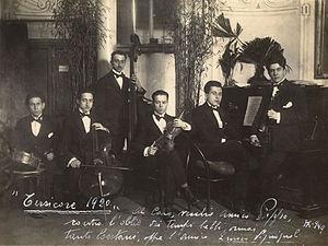 Pippo Barzizza - Pippo Barzizza at the center with his beloved violin. Genova, 1920.