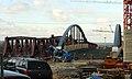 Bau der Brücke für die Tramlinie 8 neben der Friedensbrücke über den Bahnhof von Weil am Rhein.jpg
