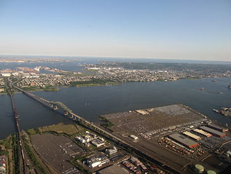 Newark Bay - Upper Bay Bridge and Newark Bay Bridge. New Jersey Turnpike. Oak Island Yard and Port Newark in foreground with Bayonne and Staten Island seen in the distance.