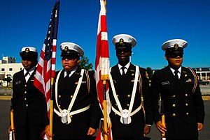 Bell Multicultural High School - Members of the BMHS Naval Junior Reserve Officers' Training Corps (NJROTC) color guard unit prepare to take the drill deck at the 15th annual NJROTC Drill Competition on Joint Base Anacostia-Bolling.