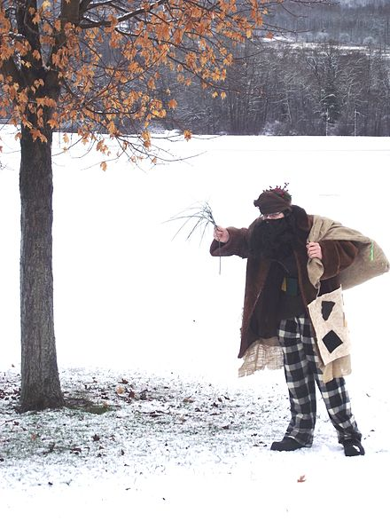 Man dressed as a modern Belsnickel in his travel attire on his way to scare children in the schools in Norwich, New York. December 2012. Belsnickel in Modern Day Travel Attire.JPG