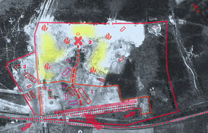 "Bełżec extermination camp - Aerial photograph of Belzec camp perimeter taken in 1944 by the Luftwaffe (common with death factories after cleanup, making sure that it is safe to abandon). Known structures are gone except for the brick-and-mortar garage and auto-shop for the SS, whose foundations still exist today (lower left). Across the fence (left), separated from the main camp, the Hiwi guards' accommodations with kitchen as well as sorting and packing yard for victims possessions. Dismantled barracks can still be seen surrounded by walking sand. The railway unloading platform, with two parallel ramps, marked with red arrow. A smaller arrow shows the holding pen for Jews still waiting to be ""processed"". Location of gas chambers marked with a cross. Undressing and hair-cropping area marked with rectangle, with fenced-out ""Sluice"" into the woods, obstructing the view of the surroundings. Cremation pyres and ash pits (yellow), upper half."