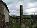 Bewcastle, the churchyard at St Cuthbert's, showing the front face of the 7thC Cross - geograph.org.uk - 958572.jpg