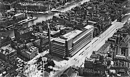 Aerial view of the Coolsingel with the famous Bijenkorf department store - architect Willem Dudok - partly destroyed during the bombing and demolished in 1960 Bijenkorf Rotterdam 1930.jpg