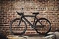 Bike against brick wall (Unsplash).jpg