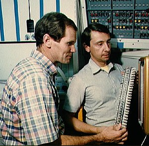 Charles D. Walker - Bill Nelson and Charles Walker inspect hardware for growth of protein crystals in space (1985).
