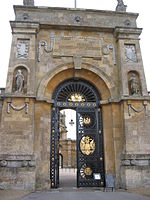 The East Gate is more the defence of a citadel than entrance to a palace. The architect slightly tapered the sides to create an illusion of even greater height and drama, as the Great Court is glimpsed through a second arch in the background.