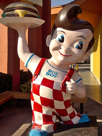 "Mascot - American chain Big Boy Restaurants feature statues of their advertising mascot, ""Big Boy"", at many of their locations."