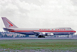 World Airways - Boeing 747-273C of World Airways at Miami Airport in 1974 wearing the early red color scheme