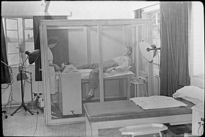 Faraday cage - An American soldier in 1944 being treated with a diathermy machine, which produces radio waves, so to keep it from causing interference with other electronic equipment in the hospital, the procedure was conducted inside a Faraday cage