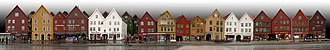 Architecture of Norway - Panoramic view of Bryggen. The eleven houses to the right were rebuilt after a fire in 1702. The six houses to the left were rebuilt after a fire in 1955.