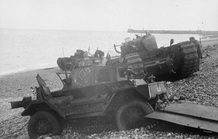 Daimler Dingo armoured car and two Churchill tanks bogged down on the shingle beach. The nearest Churchill tank has a flame thrower mounted in the hull, and the rear tank has lost a track. Both have attachments to heighten their exhausts for wading through the surf. Bundesarchiv Bild 101I-362-2211-12, Dieppe, Landungsversuch, englische Panzer.jpg