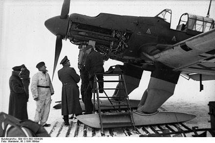 The Eastern Front brought new challenges. A Ju 87 B-2 is fitted with ski undercarriage to cope with the winter weather, 22 December 1941. Bundesarchiv Bild 101I-392-1334-04, Russland, Junkers Ju 87, Wartung.jpg