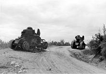 https://upload.wikimedia.org/wikipedia/commons/thumb/8/86/Bundesarchiv_Bild_146-1973-035-10,_Jugoslawien,_zerst%C3%B6rte_jugosl._Panzer.jpg/220px-Bundesarchiv_Bild_146-1973-035-10,_Jugoslawien,_zerst%C3%B6rte_jugosl._Panzer.jpg