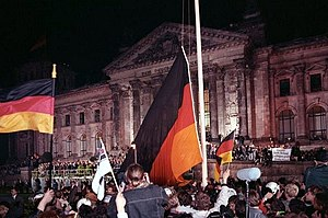 German Unity Day - The flag of unity at midnight of 3 October 1990 in front of the Reichstag