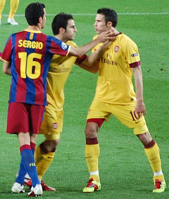 Sergio Busquets - Busquets (left) playing for Barcelona in 2011