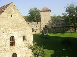 Câlnic, Alba - Main court of the Câlnic castle. The building to the left is the chapel. Behind the wall, hills surrounding the village and the castle can be seen.