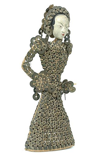 Cash coins in Indonesia - A Balinese statuette of a woman made from Chinese cash coins.