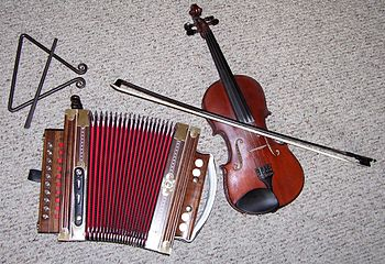 English: Typical instruments in a Cajun band.
