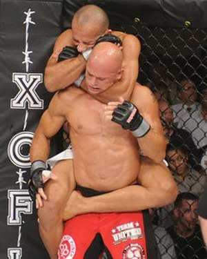 CES MMA - Magno Almeida, top, chokes out Mike Campbell in CES MMA's inaugural event in 2010.