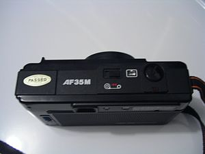 Canon AF35M - Top view; pop-up flash on left