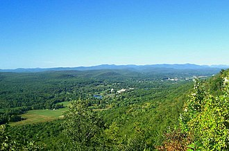 Catskill High Peaks - Seventeen of the thirty-five Catskill High Peaks are visible in this photo, taken from the Shawangunk Ridge above Ellenville. The peaks of Ulster County are in the foreground, with Greene County's Devil's Path at the far right.