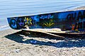 Changes of an abandoned boat on the shore of the lake.jpg