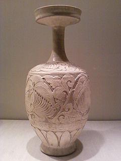 <i>Vase with carved peony scrolls</i>
