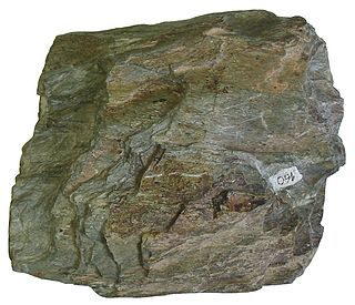 metamorphic rock formed in temperatures of 300–450 °C and pressures of 2–10 hPa, with an abundance of green minerals (e.g. chlorite, serpentine, epidote) and platy minerals (muscovite, serpentine)