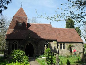 Church in the Wood, Hollington - The chancel is lower than the nave, and the tower has a tiled pyramidal cap.