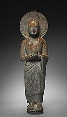 Standing Disciple Mahakasyapa Holding a Cylindrical Reliquary