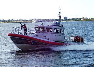 A Coast Guard patrol boat in New York Harbor a...