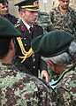 Col. Can Bolat explains to Afghan leaders some of the supplies that were donated (4699930886).jpg