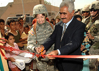 United States Army Corps of Engineers - Colonel Debra Lewis, the Gulf Region Division Central District commander with Sheik O'rhaman Hama Raheem, an Iraqi councilman, celebrate the opening of a new women's center in Assriya Village that the Corps helped construct in 2006.