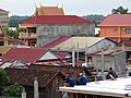 Construction Workers with Downtown Backdrop - From Roof of Savet 1 Guesthouse - Stung Treng - Cambodia (48444622792).jpg