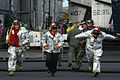 Conventionally-powered aircraft carrier USS Kitty Hawk (CV 63) crash-and-salvage Sailors run to relieve crew members manning a fire truck on the flight deck prior to the next launch cycle 060711-N-6106R-146.jpg