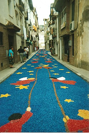 Carrer de guarnit per Corpus