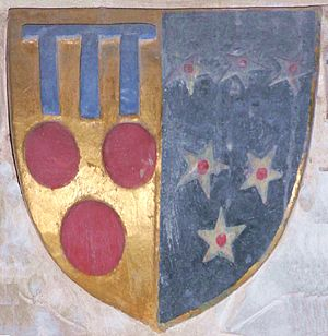 Manor of Powderham - Heraldic escutcheon on easternmost of north aisle piers in Powderham Church, Devon, showing the arms of Courtenay of Powderham impaling Bonville:  Sable, six mullets argent pierced gules. These are the arms of Sir William Courtenay (d.1485), husband of Margaret Bonville, daughter of William Bonville, 1st Baron Bonville (d.1461)