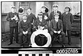Crew members of the SS STRATHGARRY, posed with the captain's terrier and two cats (3275891072).jpg