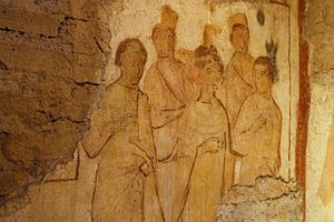 Crispus, Crispinianus, and Benedicta - This fourth-century fresco, found in the confessio (martyrdom shrine) of Saints John and Paul on the Caelian Hill, shows Crispus, Crispinianus, and Benedicta. Behind them are Roman magistrates or soldiers.