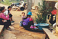 Crouching woman who does the dishes at a tribe Thailand.jpg