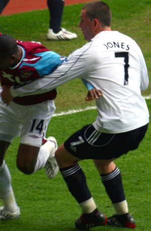 David Jones (footballer, born 1984) - Jones (7) attempted to tackle West Ham number 14 John Paintsil during his time at Derby County.