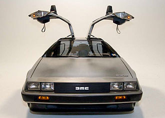 DMC DeLorean - A DeLorean from the front with the gull-wing doors open.
