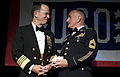 Defense.gov News Photo 100414-N-0696M-192 - Chairman of the Joint Chiefs of Staff Adm. Mike Mullen congratulates U.S. Army Master Sgt. Robert Sutherland after presenting him with the Special.jpg