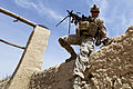 Defense.gov News Photo 120325-M-9581M-906 - U.S. Marine Corps Lance Cpl. Sergey Huber clears a 7-foot tall wall during a regimental operation in Urmoz Afghanistan on March 25 2012. Huber.jpg