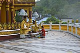 Devoted worshipper at Buddha Dhatu Jadi temple.jpg