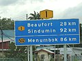 Distance signboard along Federal Route 1 (Sabah).JPG