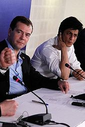 Shah Rukh Khan seated on a panel with Dmitry Medvedev in 2010