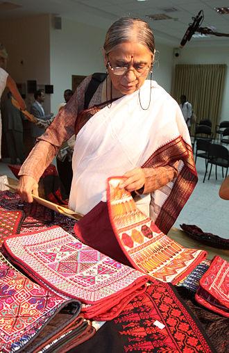 Self Employed Women's Association - Ela Bhatt, founder and past president of SEWA, appreciating the fabrics at Qalandia Women's Cooperative.